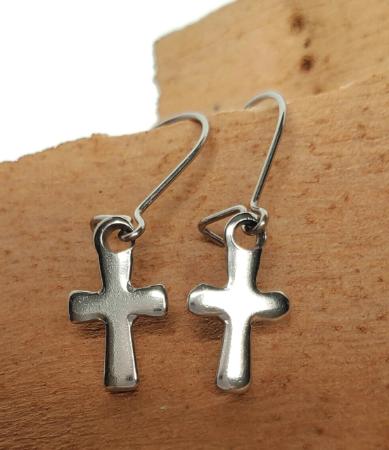 hypoallergenic stainless steel silver cross earrings on wood