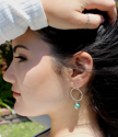 pearl hoop earrings on model