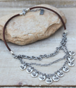 leather chain layered necklace on wood