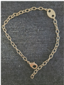 hypoallergenic chain tag anklet on denim