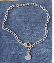 silver heart anklet on denim