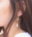 chandelier earrings on ear