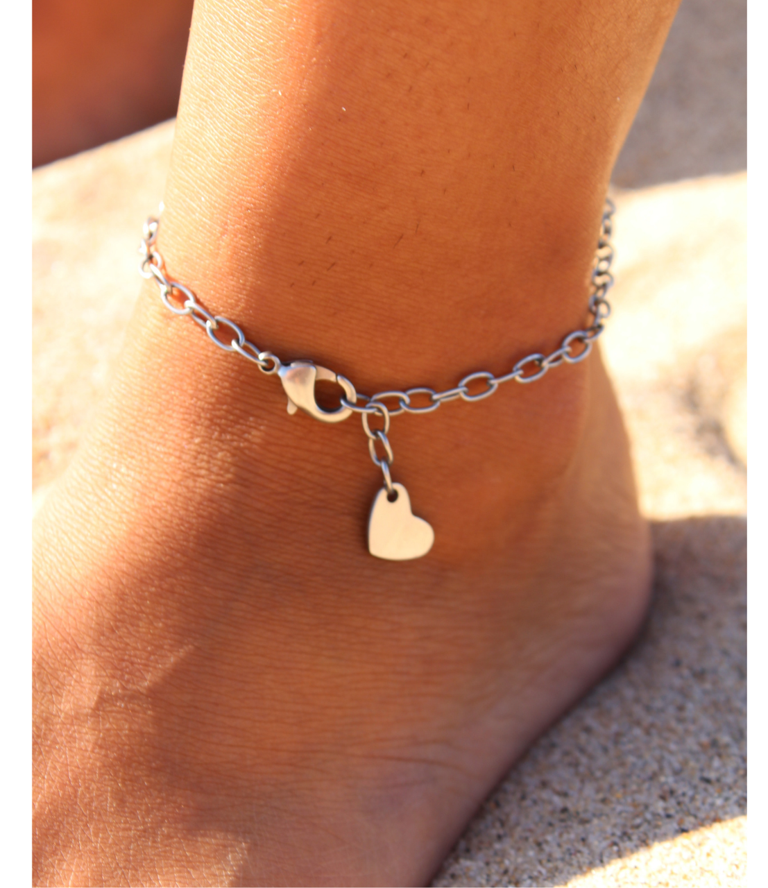 barefoot with silver heart anklet