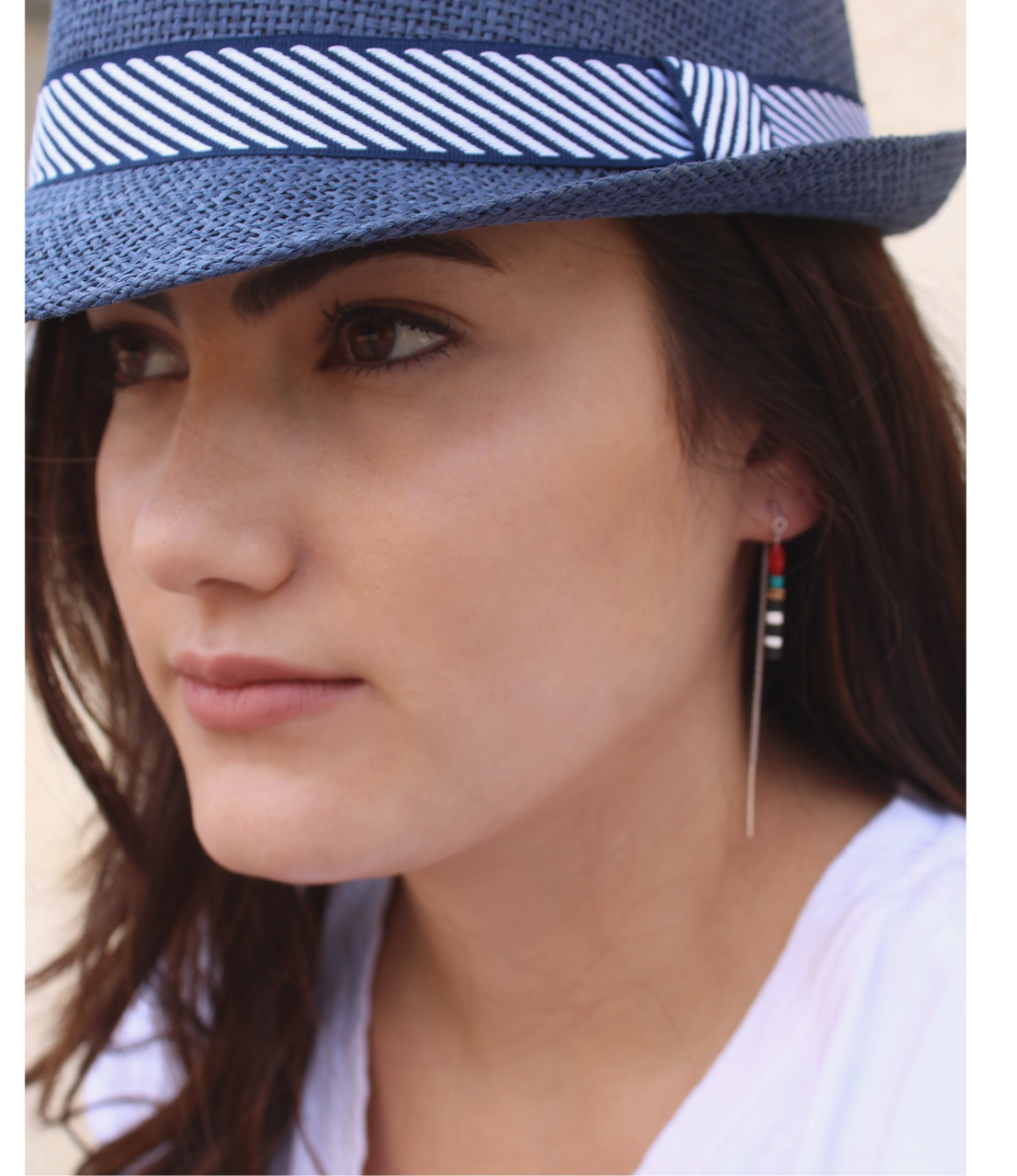 model with fedora and gemstone ear threads