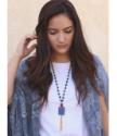 model wearing long beaded gemstone leather artisan necklace