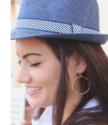 gold hoop earrings on model wearing fedora hat