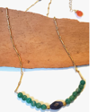 full view blue and green gemstone necklace on wood