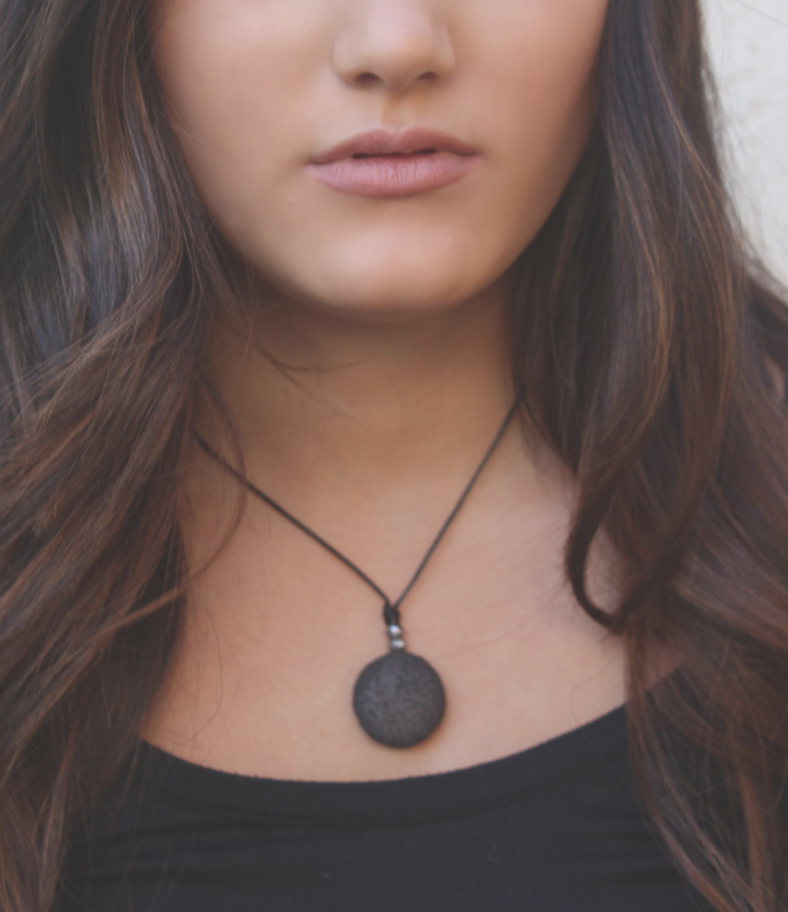 black lava leather necklace on dark haired model