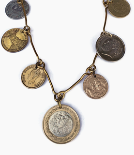 mixed metal coin statement necklace on white
