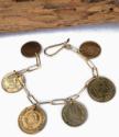 big old coin charm bracelet on white
