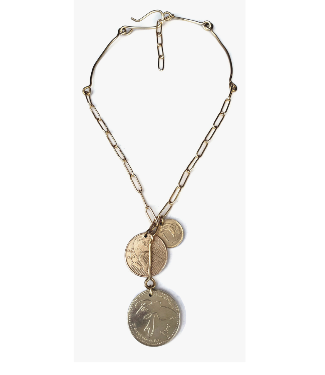 triple coins with brass chain & bar necklace on white background
