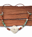white wood turquoise leather necklace on wood