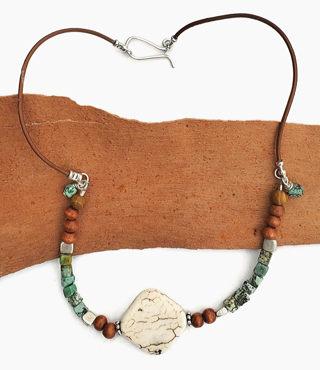 white wood turquoise leather necklace  with sterling clasp on wood