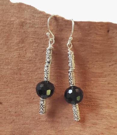 Sophisticated black gemstone earrings on wood