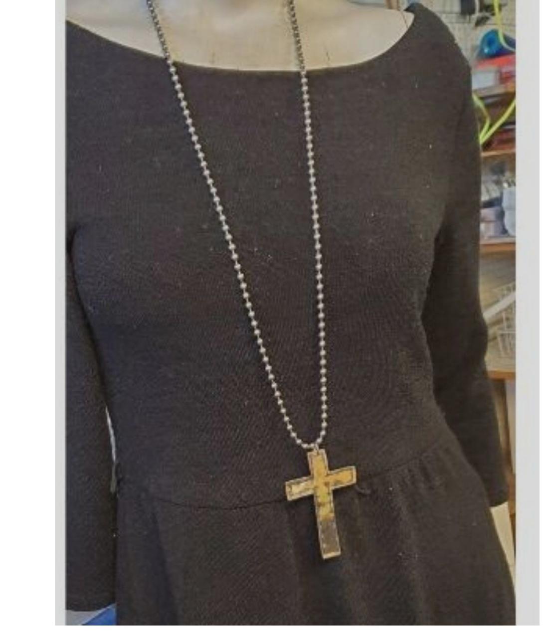 big-brass-cross-statement-necklace-on-black dress