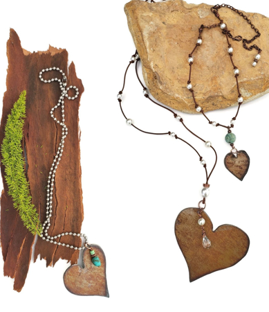 3 copper heart necklaces on wood and stone