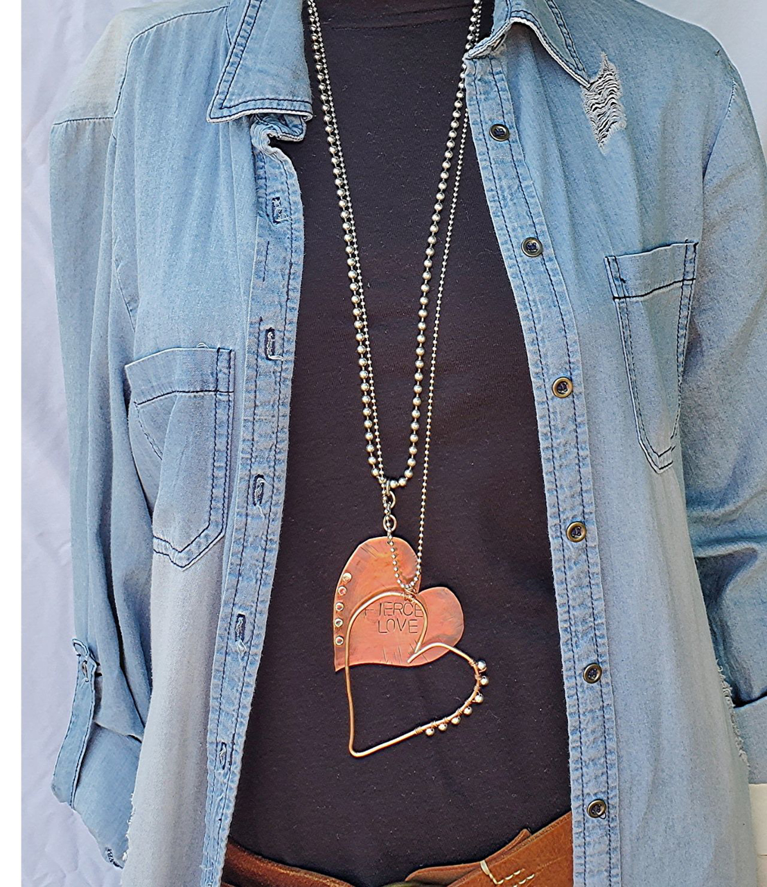 layered copper heart necklaces with denim outfit
