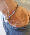 male wearing a casual cool African beaded braclet
