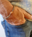Beaded stretch neutral bracelet worn by male with jeans