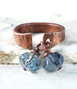 hammered copper cuff ring with blue crystals on white distressed wood