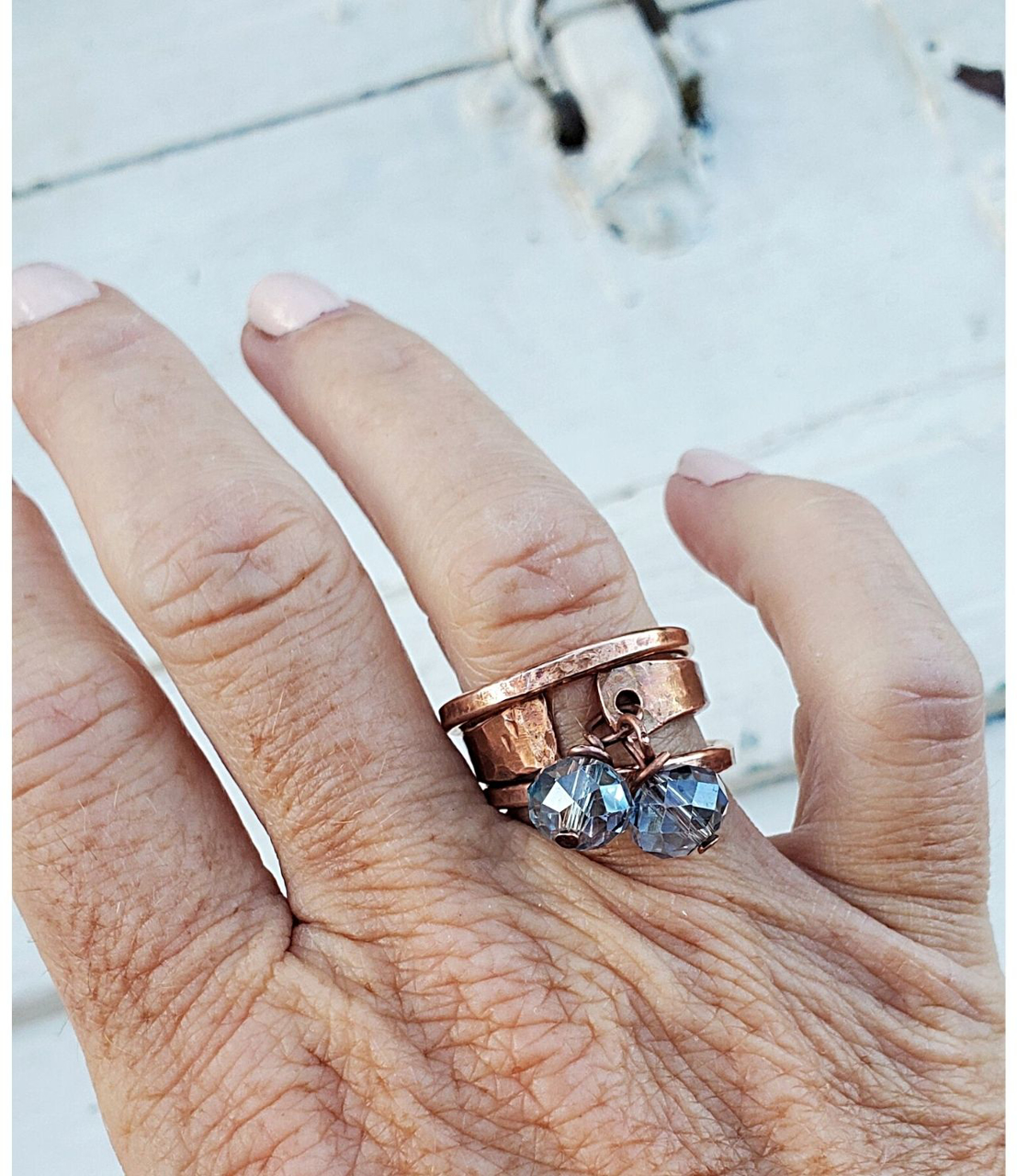 Wearing bronze band rings with blue crystal copper cuff ring