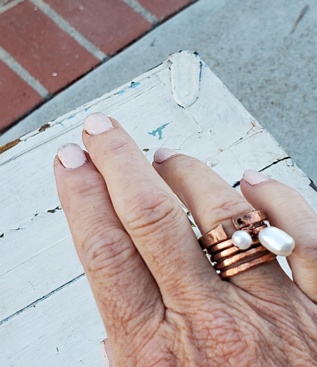 Wearing White freshwater pearl copper cuff & copper coil ring stack