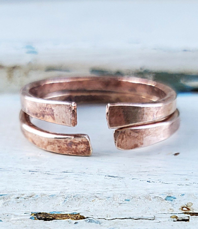 hand forged bronze cuff ring set on white distressed trunk