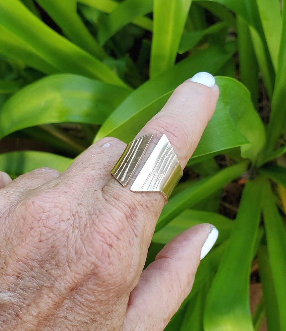wearing bronze crevice ring with plants