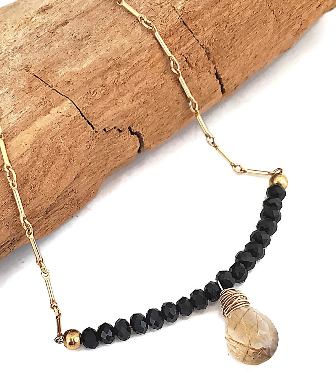 rutialted quartz gold chain necklace on wood