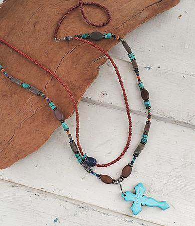 Displayed on wood layered earthy gemstone cross necklace