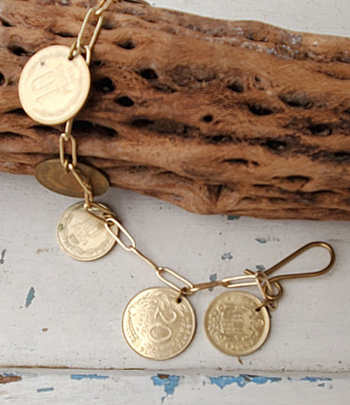gold coin chain charm bracelet on wood