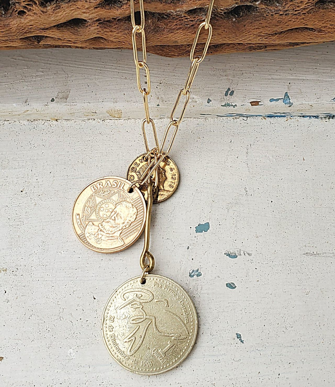 Gold Coin cluster necklace on white distressed wood