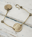 Petite gold or silver coin bracelet on white distressed wood
