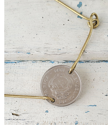 Petite silver coin  gold bar bracelet on white distressed wood