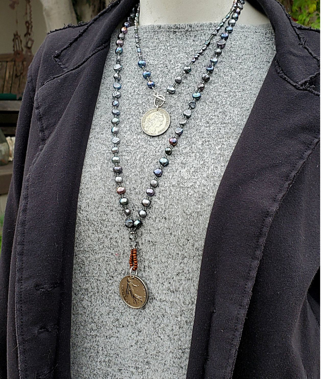 Wearing blue pearl silver coin layered necklaces