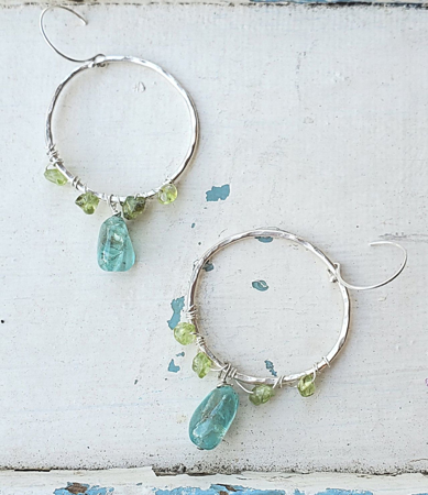 Silver hoop chandelier blue green gemstone earrings on white distressed wood