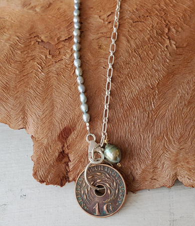 Blue pearl silver chain Nederland coin necklace on wood