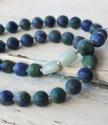 blue and aqua gemstones on white distressed wood
