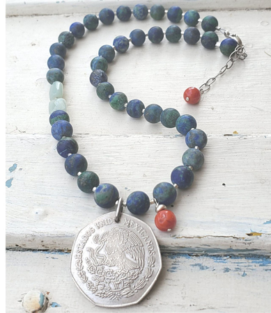 1977 silver Mexican coin  vibrant gemstone necklace full view on white wood