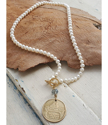 White pearl-gold-Finland coin necklace full view on wood