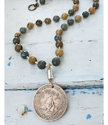 Big Tahiti coin earthy gemstone necklace on white wood