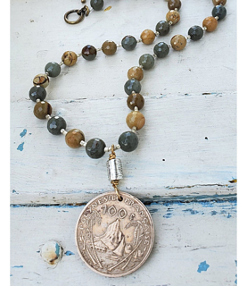 Big Tahiti coin earthy gemstone necklace on white wood