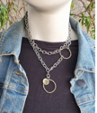 Layered chunky chain mixed metal necklace with black top & jean jacket