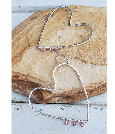 Handcrafted silver open heart earrings on stone