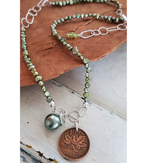 Old 1950 Canada Coin necklace with green pearls on wood