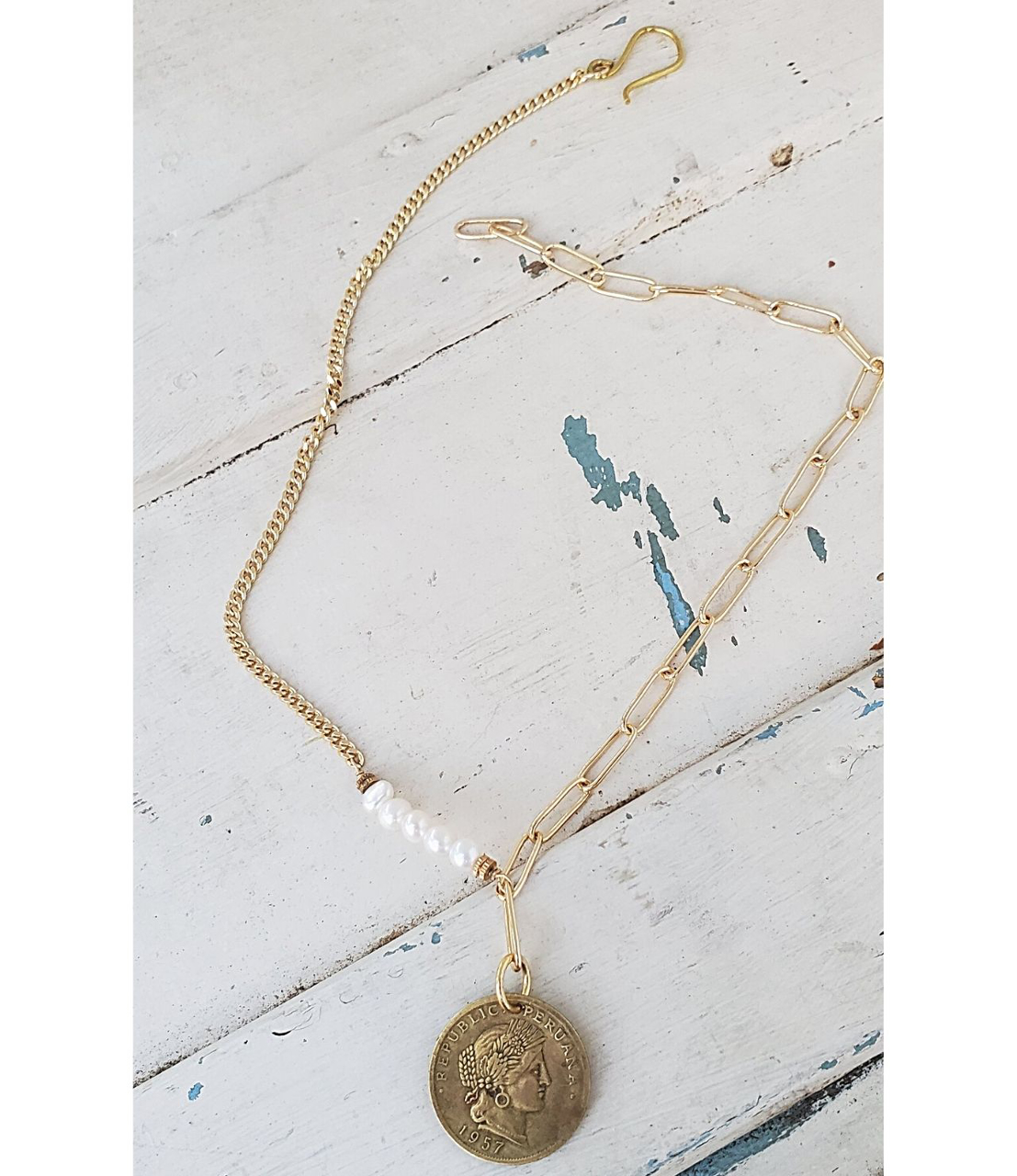 full view mixed gold chain pearl coin necklace on white wood