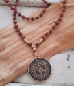 Japan coin gemstone necklace on textured material