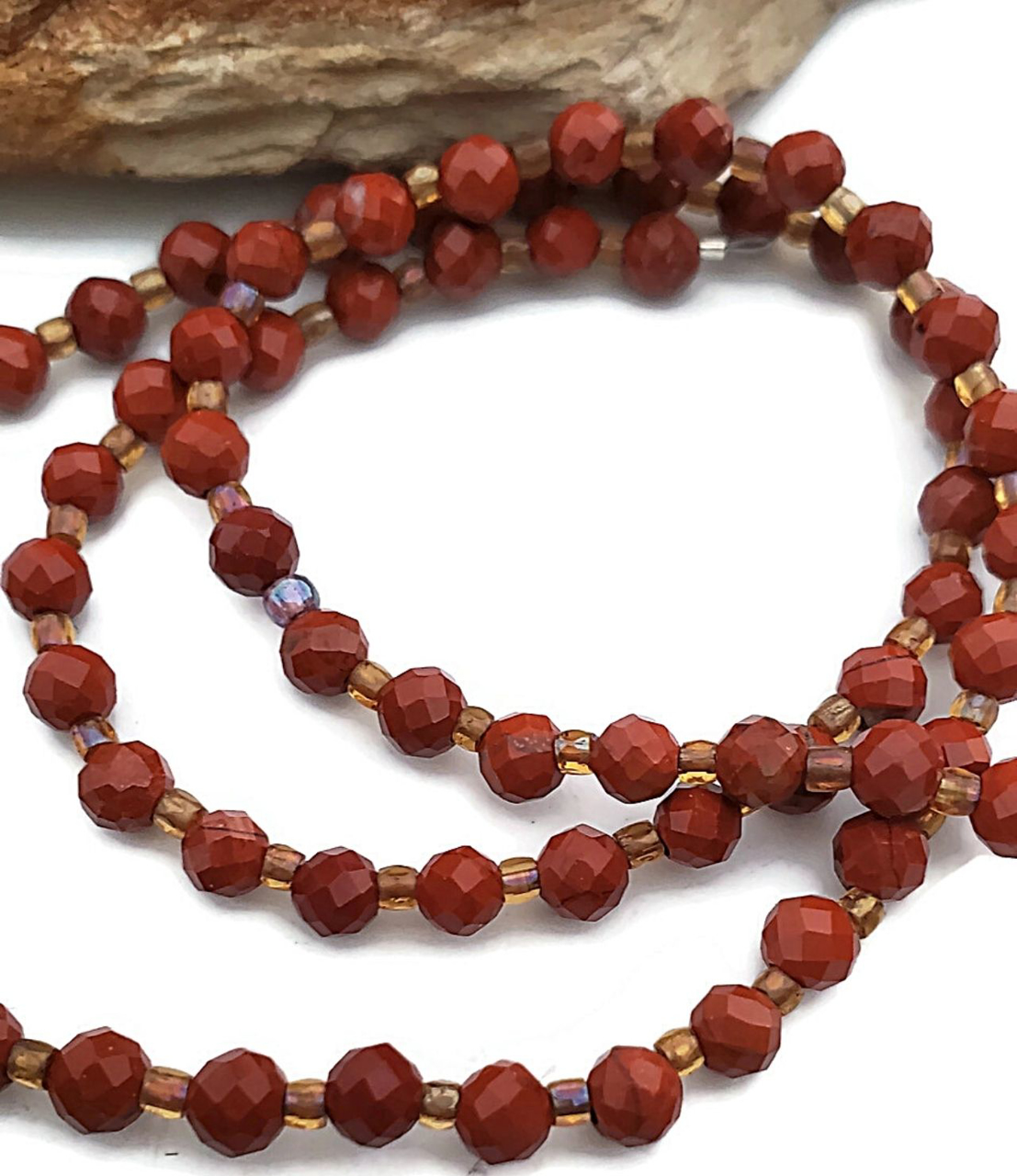 close up red gemstone necklace strand