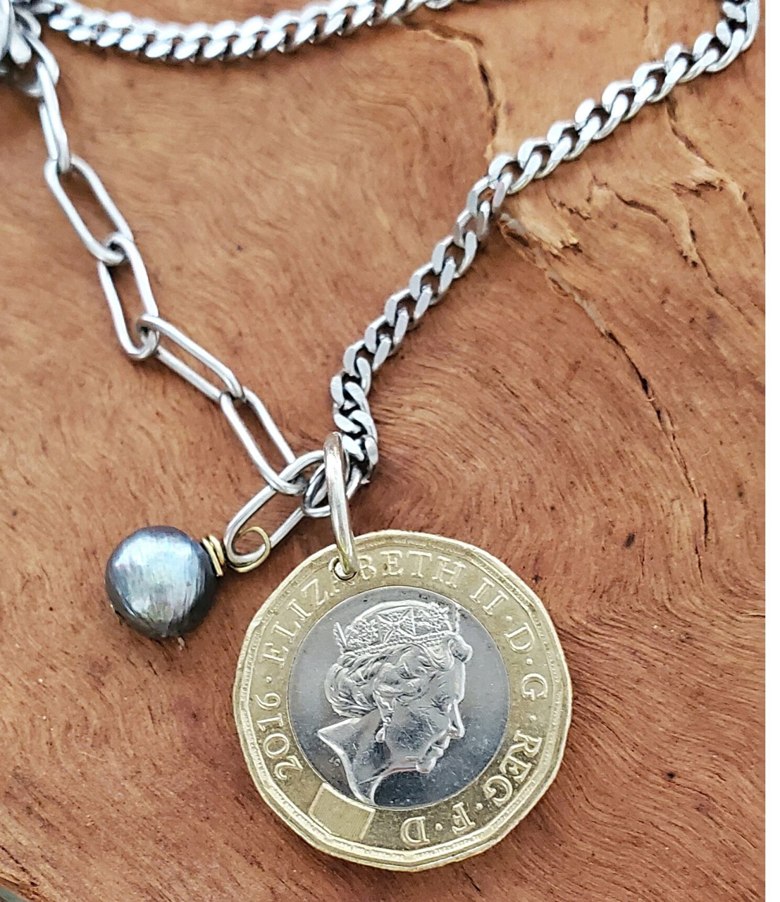 Close up mixed metal vintage coin necklace