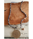 Full view Jamaica coin pearl necklace on wood